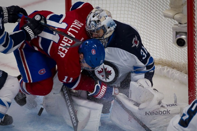 Brendan Gallagher et Ondrej Pavelec... (PHOTO BERNARD BRAULT, ARCHIVES LA PRESSE)