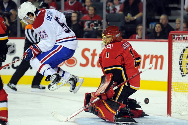 David Desharnais et Jonas Hiller... (PHOTO ARCHIVES USA TODAY)