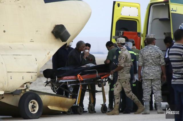 Le bilan de l'écrasement s'élève à 224 morts.... (AFP, Khaled Desouki)