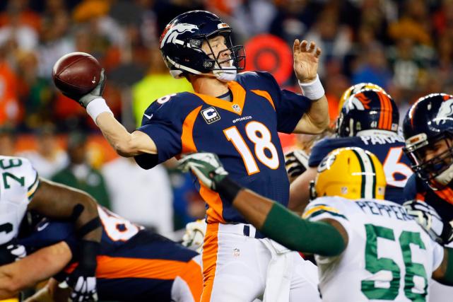 Peyton Manning a égalé le record de Brett... (Photo Jack Dempsey, AP)