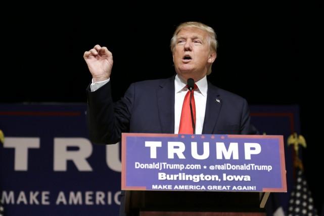 Donald Trump, sans expliquer comment, appelle aussi à... (Archives AP, Charlie Neibergall)