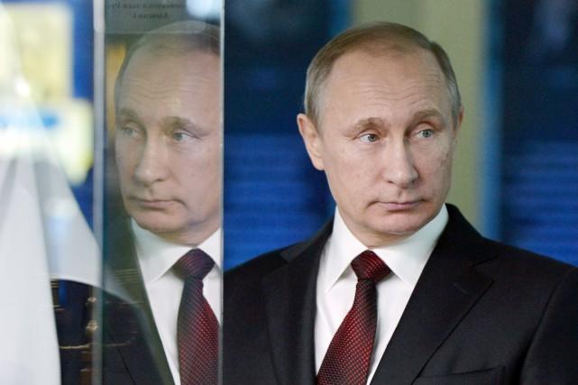 PourForbes, Vladimir Poutine «continue à prouver qu'il est... (PHOTO ALEKSEY NIKOLSKY, ARCHIVES RIA-NOVOSTI/AFP)