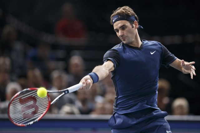 Roger Federer s'est moqué de l'Italien Andreas Seppi... (Michel Euler, Associated Press)