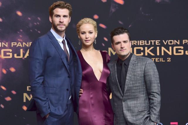 Liam Hemsworth, Jennifer Lawrence et Josh Hutcherson arrivent... (AFP, John MacDougall)