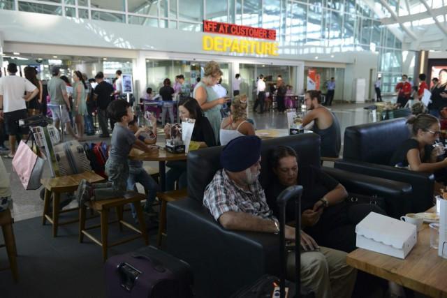 Près de 700 vols au départ ou à... (AFP, Sonny Tumbelaka)