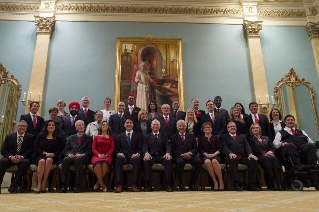 Cinq des 15 femmes nommées au sein du... (PhotoAdrian Wyld, archives La Presse Canadienne)