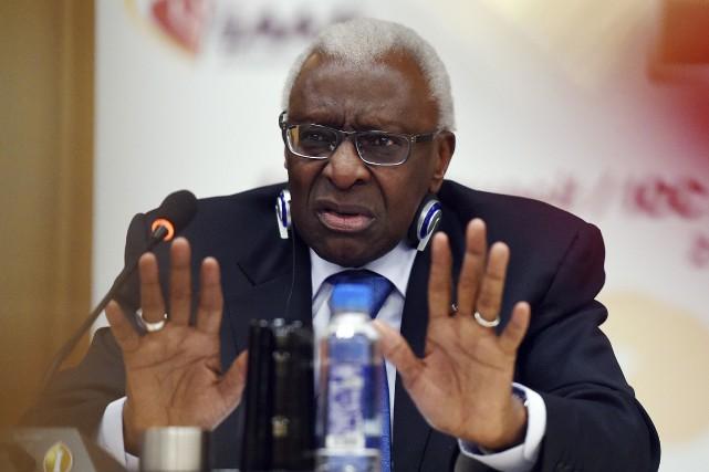 Le président de la fédération d'athlétisme, Lamine Diack,... (Photo Greg Baker, archives AFP)