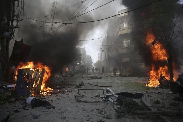 Selon l'OSDH, au moins six enfants et sept... (Photo Bassam Khabieh, Reuters)