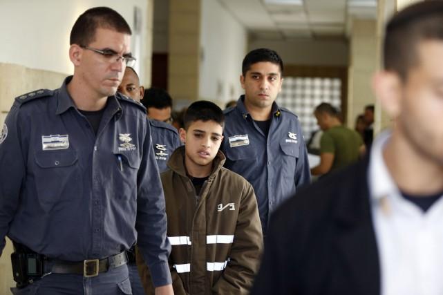 Ahmed Manasra (ci-dessus), 13 ans, et son cousin... (PHOTO AHMAD GHARABLI, AFP)