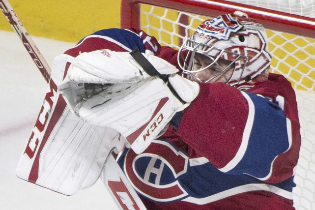 Le gardien vedette du Canadien se rétablit plus... (Graham Hughes, La Presse Canadienne)