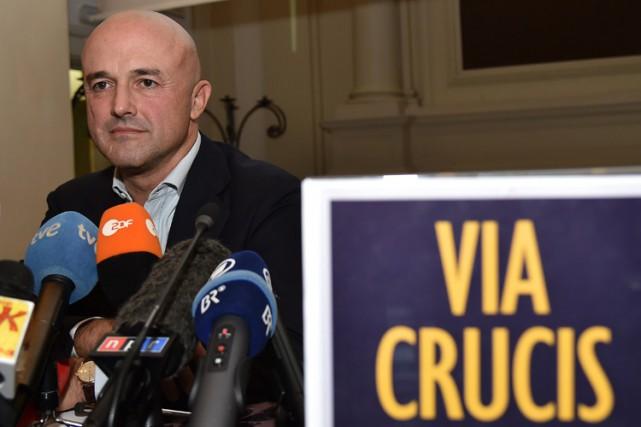 Les deux journalistes italiens placés sous enquête par... (PHOTO AFP)