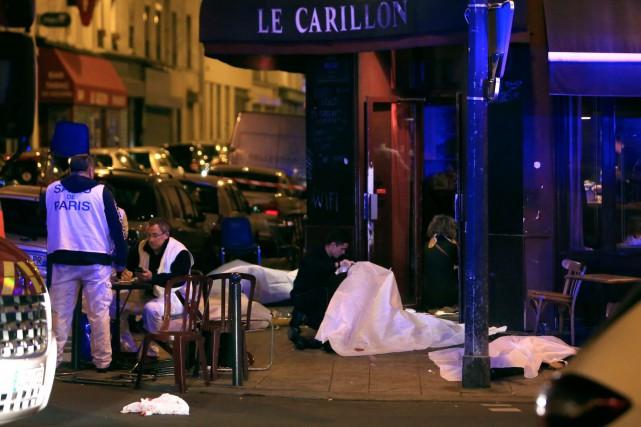 Une fausse victime des attentats de Paris prétendaitavoir... (AP, Thibault Camus)