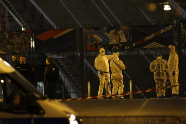 Investigating police officers are pictured outside the Stade...