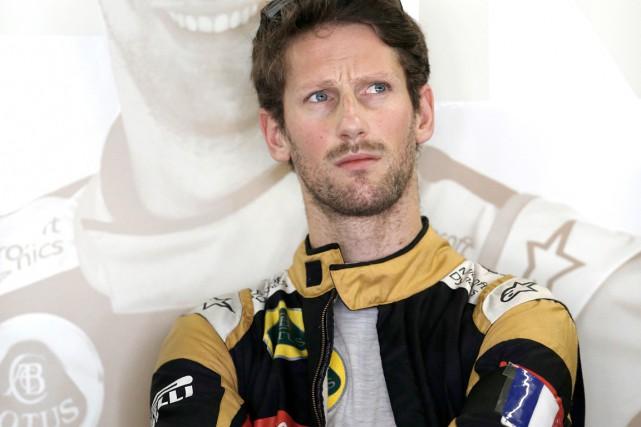 Le pilote français Romain Grosjean (Lotus) a entamé... (AP, Silvia Izquierdo)