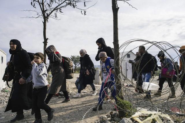 L'accueil de 25 000 réfugiés syriens soulèvent les... (Agence France-Presse)