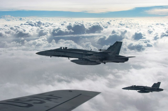 Des CF-18 Hornet en mission, le 30 octobre.... (Photo archives La Presse Canadienne)