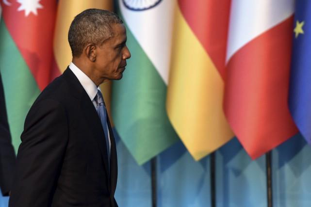 Barack Obama a dénoncé les attentats de Paris,... (Agence France-Presse)
