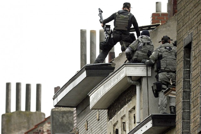Une opération policière d'envergure, qui a eu lieu,... (AFP, Dirk Waem)