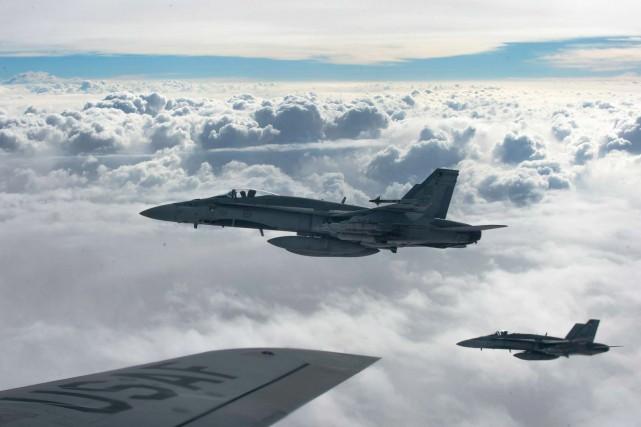 «Rappeler les CF-18, même si leur fonction n'est... (PHOTO ARCHIVES REUTERS)