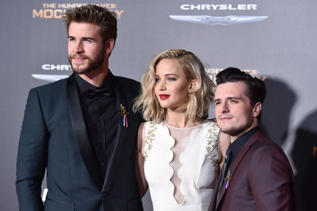 Liam Hemsworth, Jennifer Lawrence et Josh Hutcherson à... (AP)