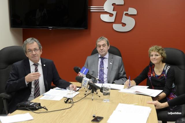 Jacques Munger, directeur de la STS, Réjean Hudon,... (Photo Le Quotidien, Jeannot Lévesque)