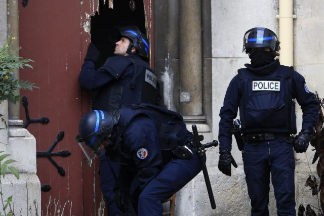 French police officers storm a church after a... (Photo Thibault Camus)