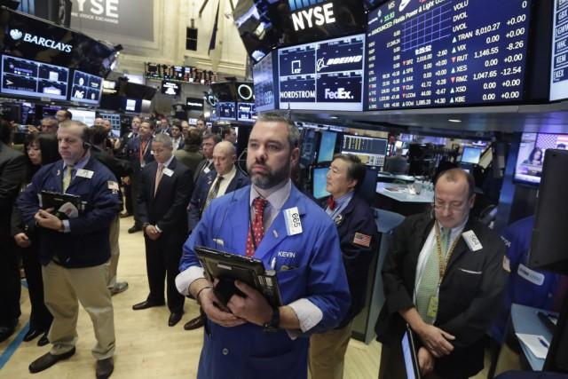 Les dividendes versés aux actionnaires dans le monde ont baissé en 2015 de 2,2... (AP, Richard Drew)