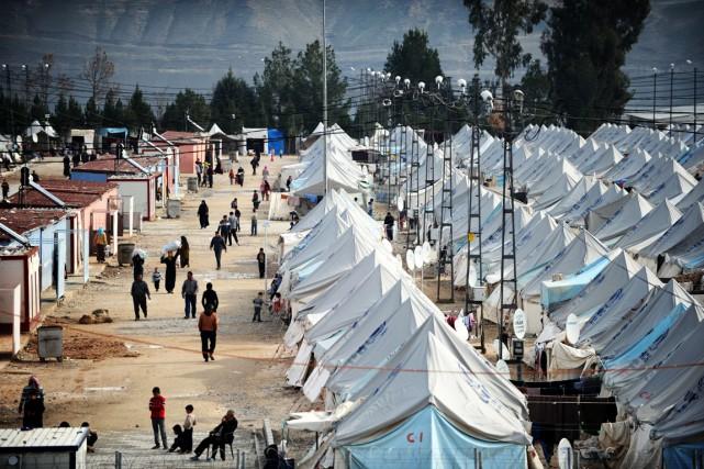 La majorité des Syriens qui ont fui la... (PHOTO OZAN KOZE, ARCHIVES AGENCE FRANCE-PRESSE)