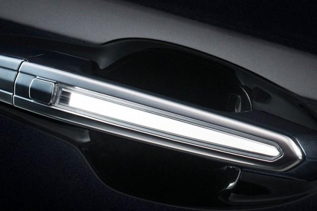 Les poignées de porte du Cadillac XT5 s'illuminent... (Photo fournie par General Motors)