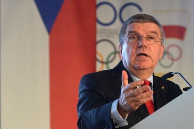 Le président du CIO, Thomas Bach.... (Photo Michal Cizek, AFP)