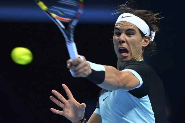 Rafael Nadal a mis 2 heures 37 minutes... (AFP, Glyn Kirk)
