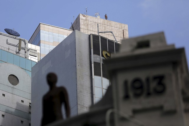 L'installation d'Antony Gormley est «une invitation à lever... (AFP, Isaac Lawrence)