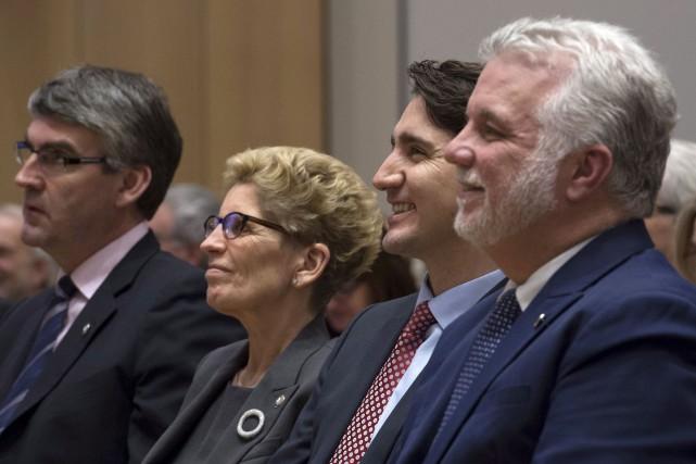 En fin d'après-midi, les premiers ministres ont assisté... (Adrian Wyld, PC)