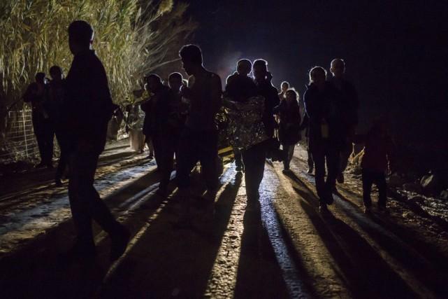 Des réfugiés qui viennent d'atteindre la Grèce, fin... (Archives AP)
