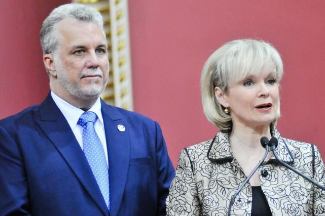 Philippe Couillard et Julie Boulet lors de l'assermentation... (Archives, Émilie O'Connor)