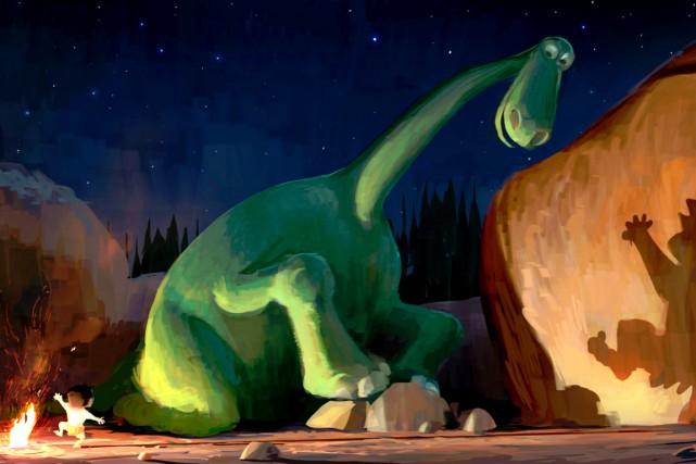 Perdu, le jeune dinosaure Arlo obtient l'aide et... (Fournie par Pixar-Disney)