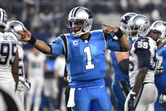 Le quart-arrière des Panthers, Cam Newton... (Photo Michael Ainsworth, AP)