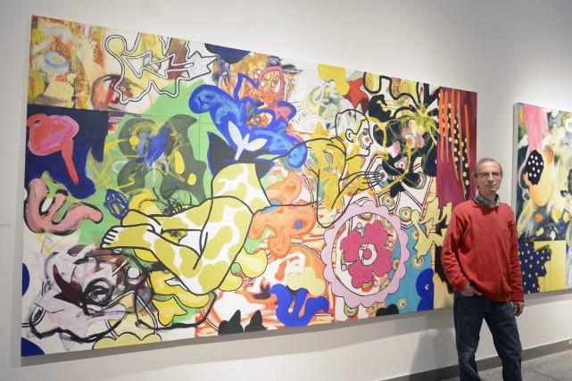 Michel Martineau en est à sa première exposition... (Photo Le Progrès-Dimanche, Jeannot Lévesque)