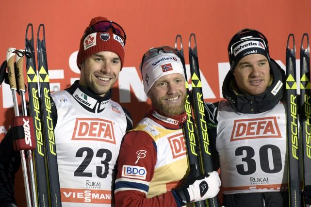 Alex Harvey (23) a obtenu la deuxième place... (AP, Heikki Saukkomaa)
