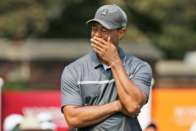 Tiger Woods n'a pas disputé un tournoi depuis... (AP, Chuck Burton)