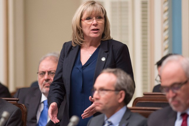 La ministre de la Famille, Francine Charbonneau, entend... (PHOTO JACQUES BOISSINOT, LA PRESSE CANADIENNE)