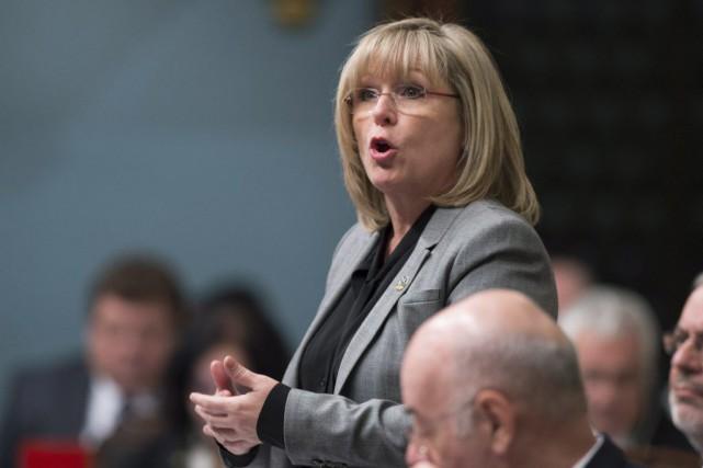 La ministre de la Famille, Francine Charbonneau... (PHOTO JACQUES BOISSINOT, LA PRESSE CANADIENNE)
