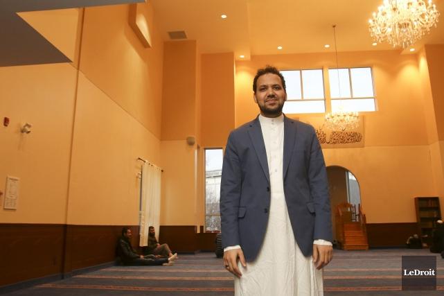Avec le prêtre Michel Lacroix,l'imam Ahmed Limame (notre... (Patrick Woodbury, Archives LeDroit)
