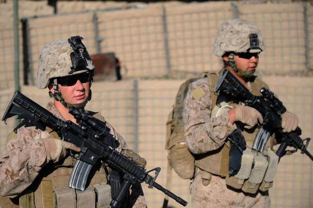 Les femmes pourront accéder à tous les postes... (PHOTO ARCHIVES AFP)