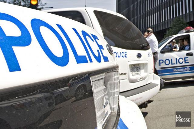 Le DPCP a considéré que les policiers sont... (PHOTO PATRICK SANFAÇON, ARCHIVES LA PRESSE)