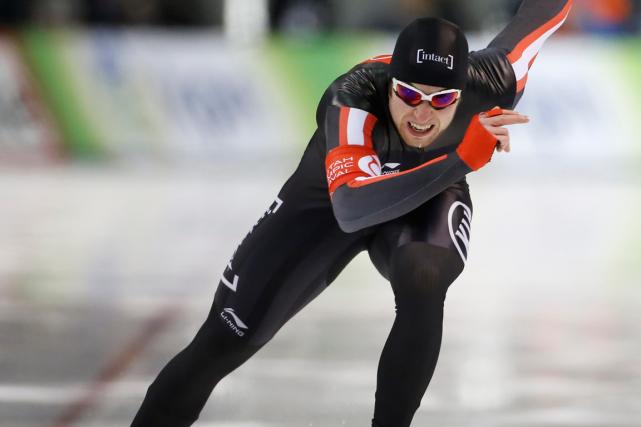 Le patineur québécois Alexandre St-Jean a terminé deuxième... (Archives AP, George Frey)