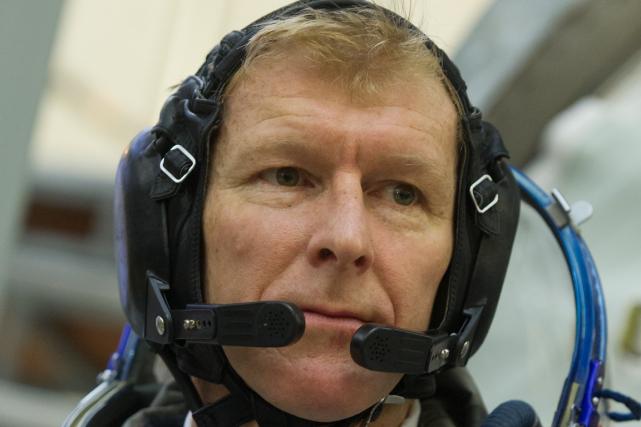 L'astronaute britannique Tim Peakeva courir les 42,195 km... (Photo AFP)