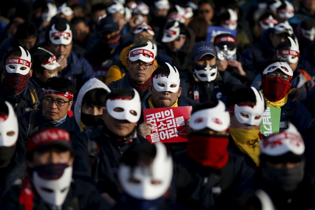 Des manifestants se sont rassemblés à Séoul pour... (PHOTO KIM HONG-JI, REUTERS)