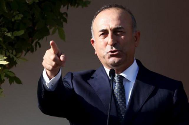Mevlut Casuvoglu, le ministre des Affaires étrangères de... (Photo Yiannis Kourtoglou, Reuters)