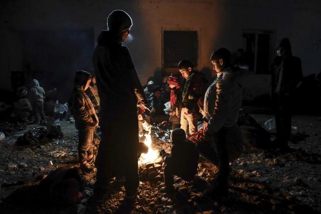 Les réfugiés qui débarqueront en sol canadien au... (Agence France-Presse)